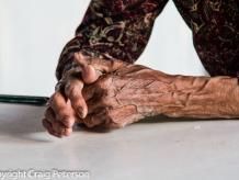 An elderly farmer's hands
